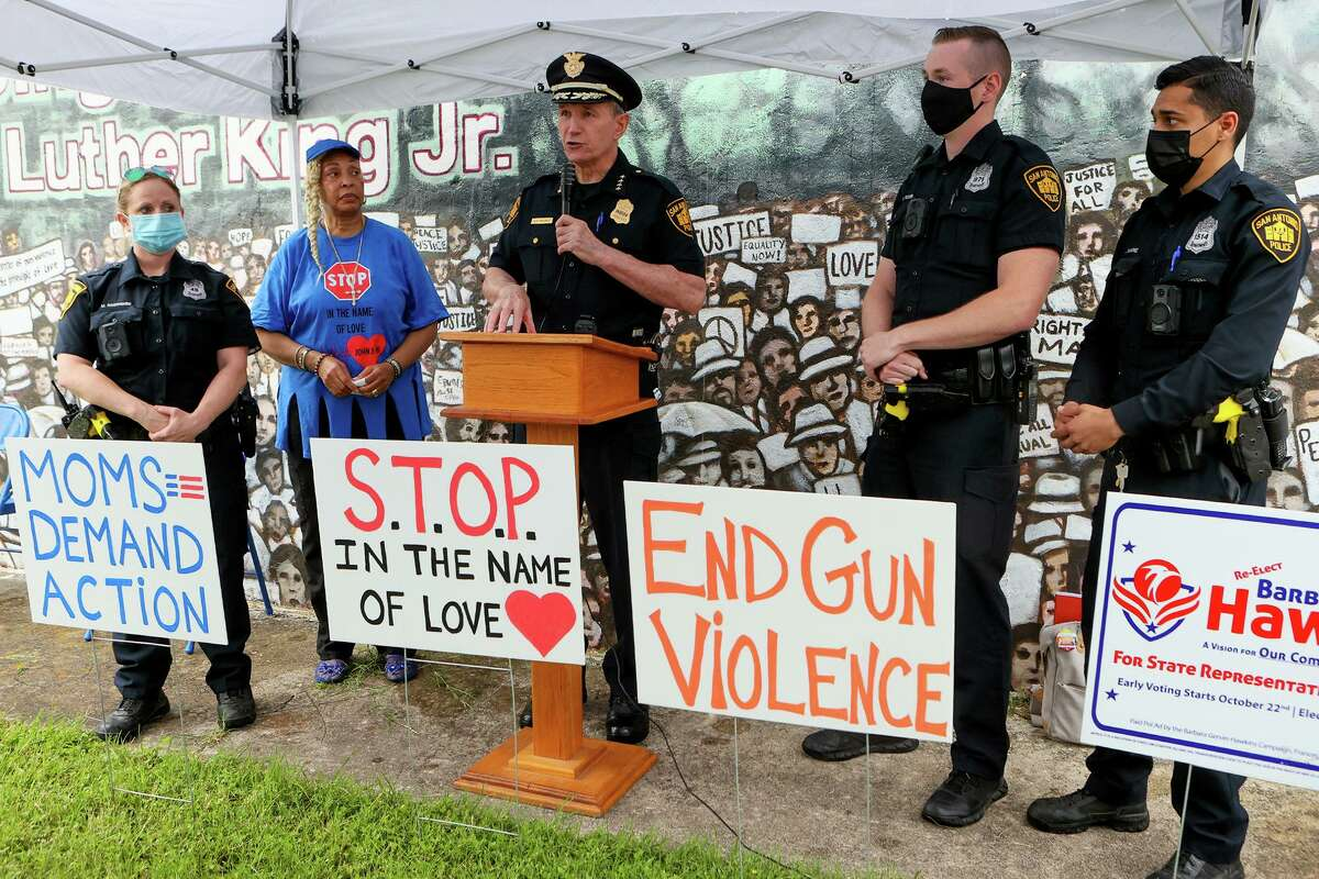 San Antonio Police Chief William McManus speaks at Sunday's rally highlighting the need for healing and action on gun violence prevention. Standing beside him are, from right, SAFFE officers Justin Ramirez, Michael Fisher and Meredith Rodriguez and Rosa Wilson, bishop and Chief Apostle of the Greater Faith Institutional Church, where the rally was held.