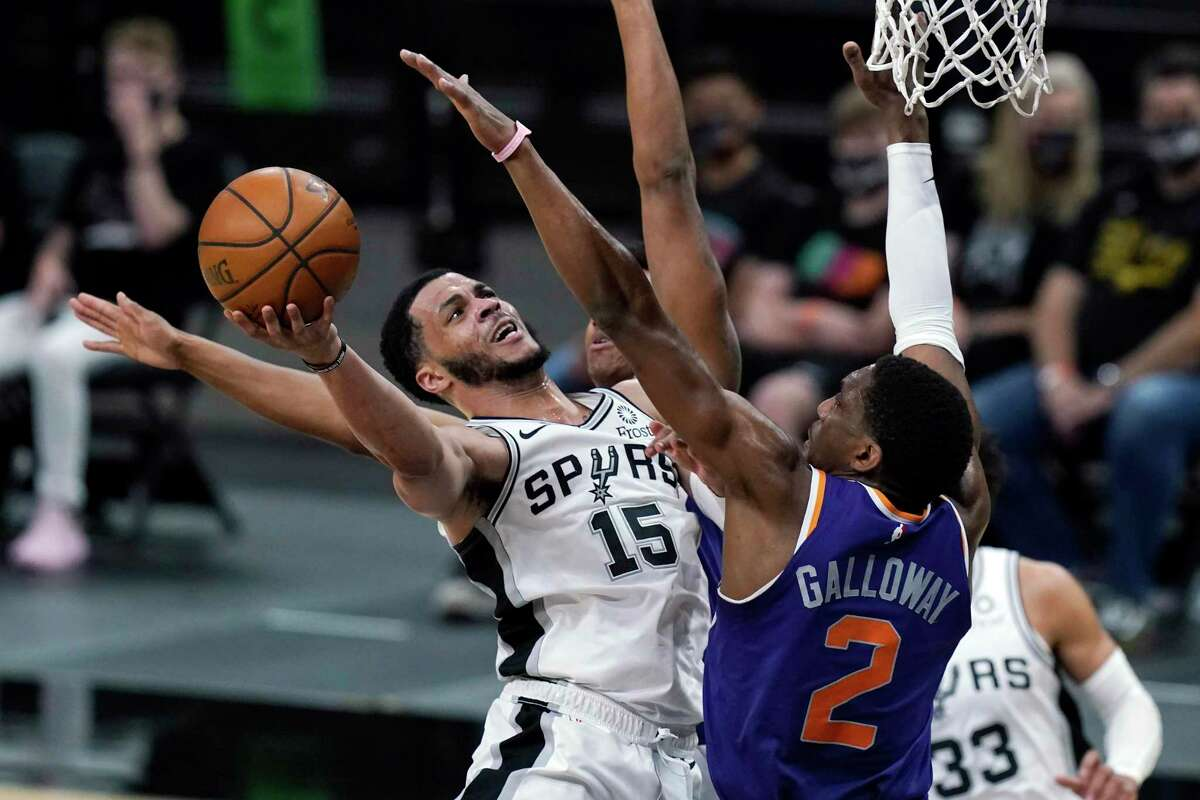 San Antonio Spurs guard Quinndary Weatherspoon (15) drives to the basket against Phoenix Suns guard Langston Galloway (2) during the second half of an NBA basketball game in San Antonio, Saturday, May 15, 2021. (AP Photo/Eric Gay)