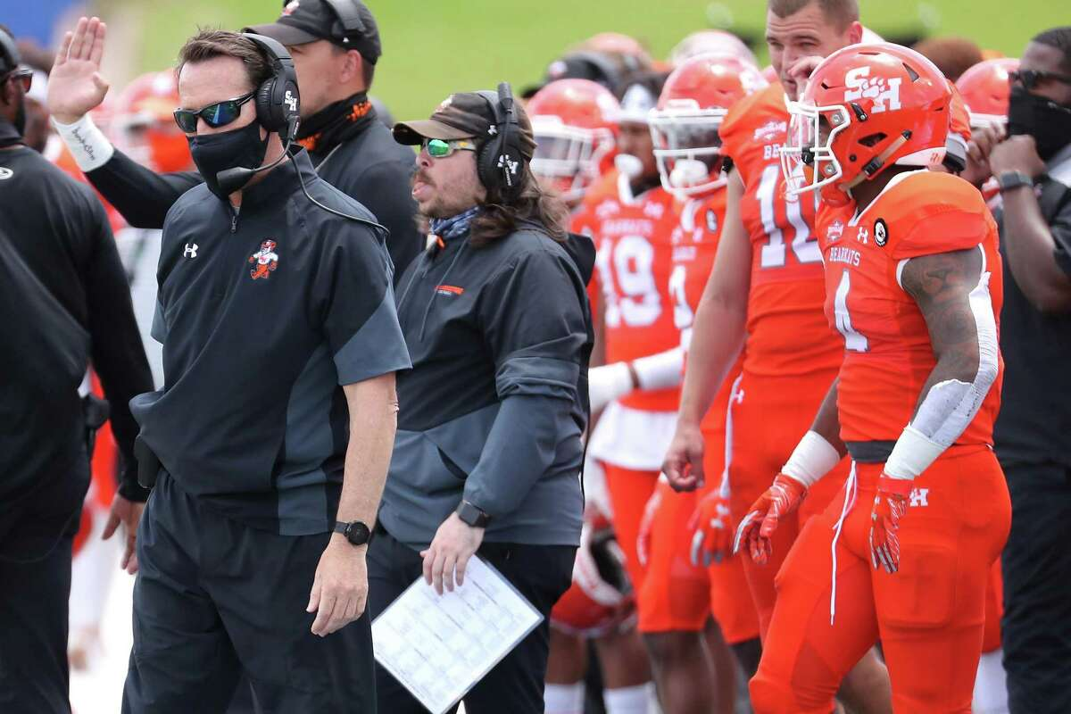 Sam Houston State head coach K. C. Keeler works the sidelines during the first quarter of a semifinal game in the NCAA FCS football playoffs on Saturday, May 8, 2021, in Huntsville. Sam Houston came from behind to edge James Madison 38-35, for a berth in the FCS national championship game.