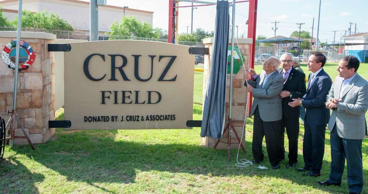 Felix Cruz, Conrado Cruz, Juan Cruz and Laredo City Councilmember Albert Torres gather to unveil the Cruz Field monument, Friday, May 14, 2021, during a ceremony.