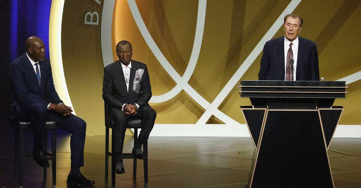 Class of 2020 inductee, Rudy Tomjanovich speaks alongside presenters Calvin Murphy and Hakeem Olajuwon during the 2021 Basketball Hall of Fame Enshrinement Ceremony at Symphony Hall on May 15, 2021 in Springfield, Massachusetts. (Photo by Maddie Meyer/Getty Images)