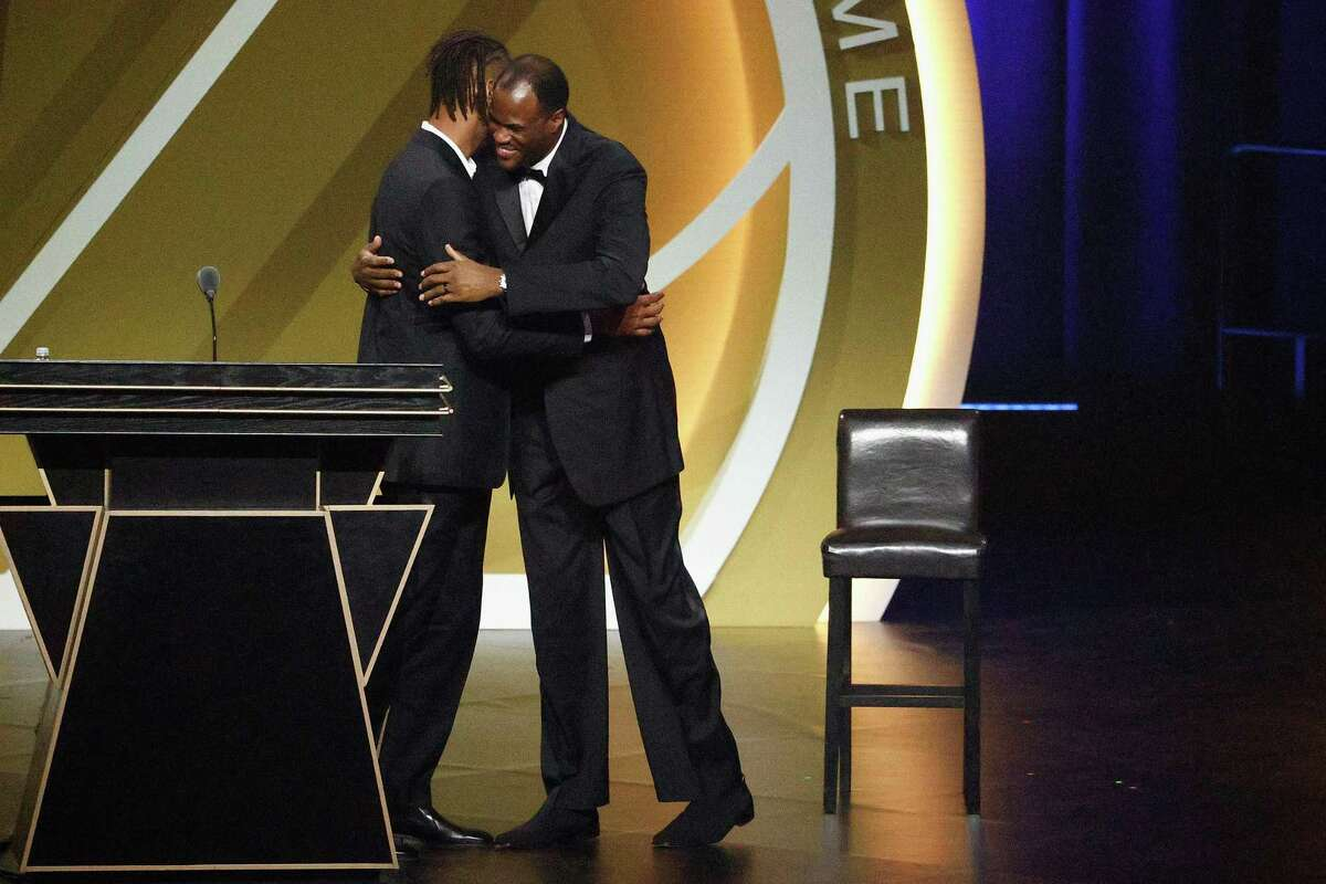 David Robinson hugs Tim Duncan before presenting him for induction into the Naismith Memorial Basketball Hall of Fame on Saturday at Mohegan Sun Arena in Uncasville, Conn.