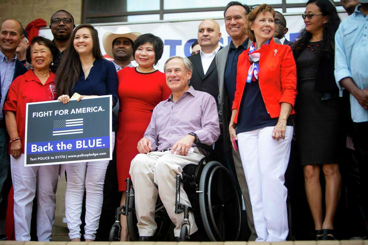 Texas Gov. Greg Abbott poses for a group picture with leaders during a