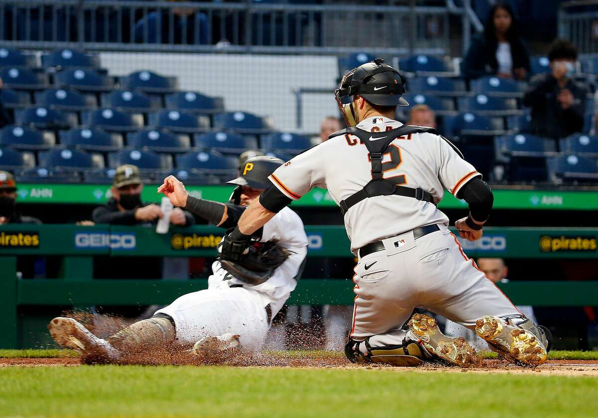 PITTSBURGH, PA - MAY 15: Curt Casali #2 of the San Francisco Giants tags out Ka'ai Tom #60 of the Pittsburgh Pirates in the fifth inning at PNC Park on May 15, 2021 in Pittsburgh, Pennsylvania. (Photo by Justin K. Aller/Getty Images)