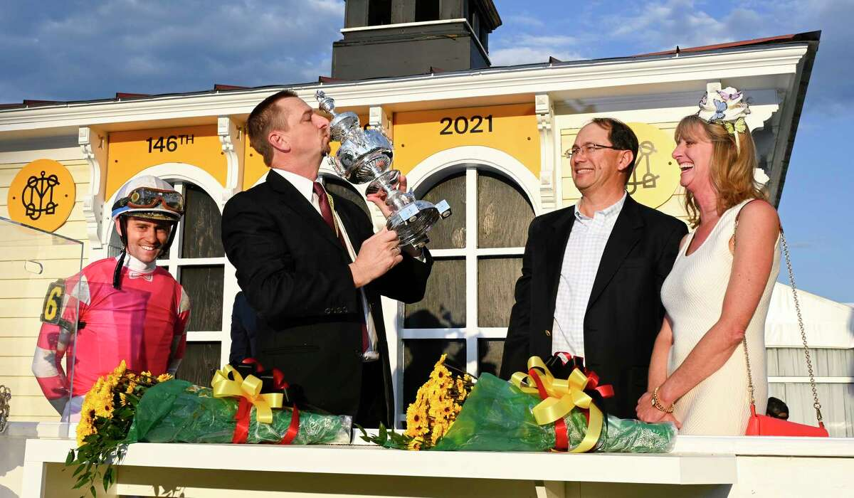 Trainer Mike McCarthy kisses the winner's trophy after Rombauer, with jockey Flavien Prat, won the 146th running of the Preakness Stakes at Pimlico Race Course on Saturday, May 15, 2021. Rombauer won't be running at Saratoga, but McCarthy has Ce Ce in the Ballerina on Saturday.