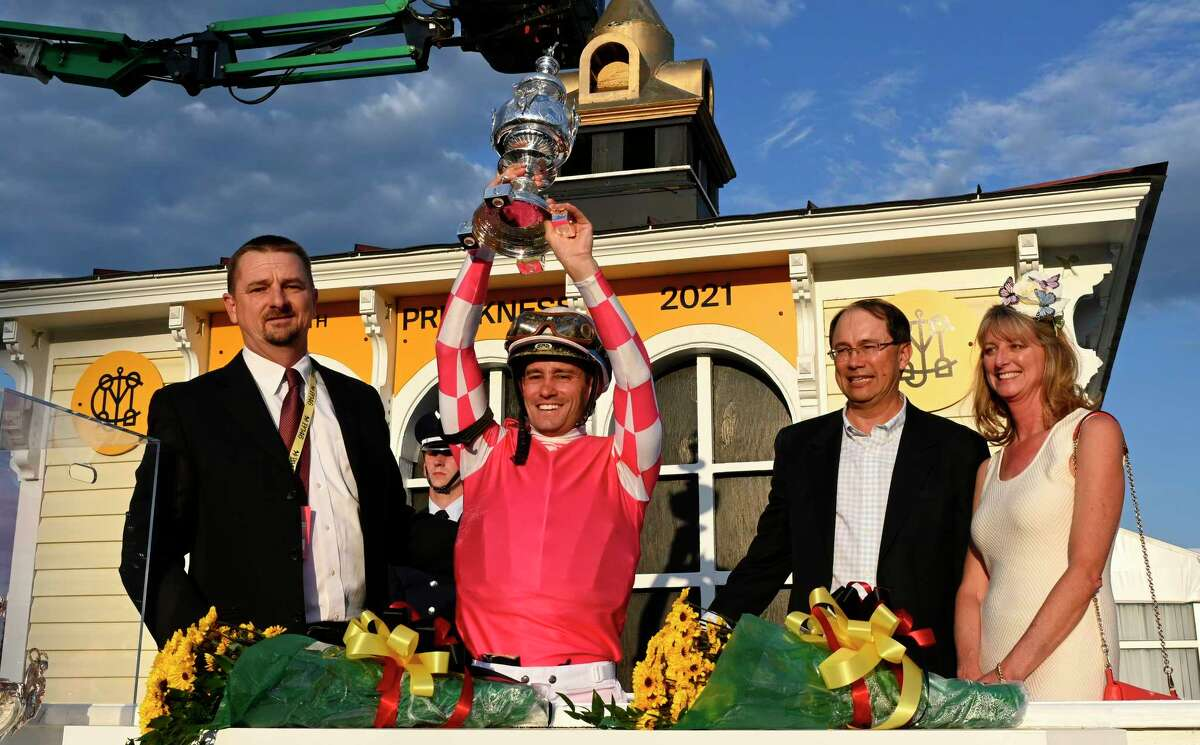 Jockey Flavien Prat holds up the winner?•s trophy after he rode Rombauer to the win in the 146th running of the Preakness Stakes at Pimlico Race Course Saturday May 15, 2021 in Baltimore, MD. Photo Special to the Times Union by Skip Dickstein