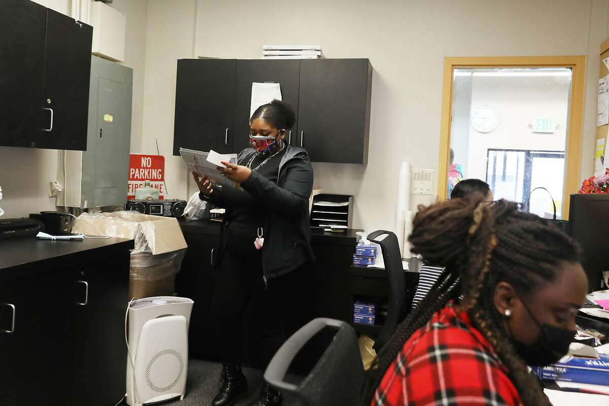 Fiscal clerk Lenise Beal collects mail for a client while working the front desk of the medical office of Bay Area Addiction Research Treatment in San Francisco.