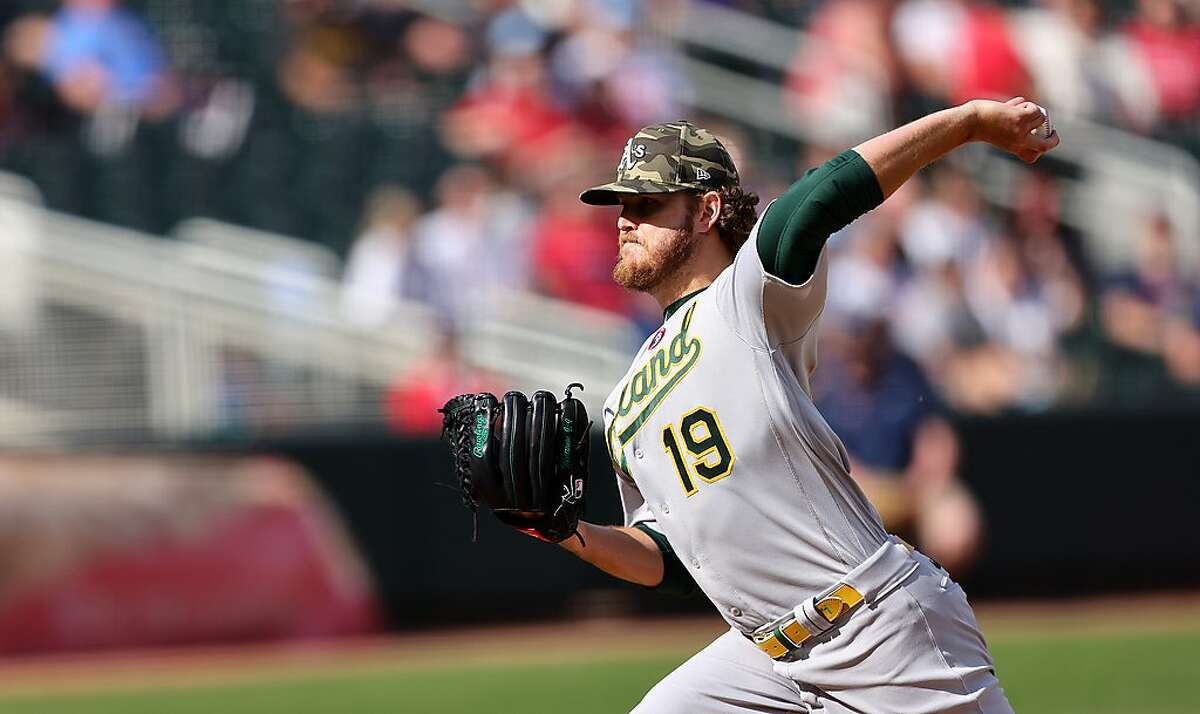 MINNEAPOLIS, MINNESOTA - MAY 15: Cole Irvin #19 of the Oakland Athletics pitches in the sixth inning against the Minnesota Twins at Target Field on May 15, 2021 in Minneapolis, Minnesota.(Photo by Adam Bettcher/Getty Images)
