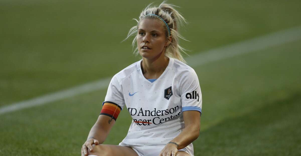 Houston Dash forward Rachel Daly (3) sits on the ground and reacts after missing a pass during the first half of an NWSL soccer match against Gotham FC, Saturday, May 15, 2021, in Harrison, N.J. (AP Photo/Steve Luciano)