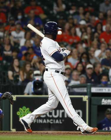 Houston Astros designated hitter Yordan Alvarez (44) fouls a ball off his hand during the sixth inning of an MLB baseball game at Minute Maid Park, Saturday, May 15, 2021, in Houston. Photo: Karen Warren/Staff Photographer / @2021 Houston Chronicle