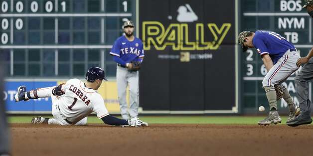 Houston Astros Carlos Correa (1) slides into second base as Texas Rangers second baseman Nick Solak (15) struggled with the ball during the seventh inning of an MLB baseball game at Minute Maid Park, Saturday, May 15, 2021, in Houston. Photo: Karen Warren/Staff Photographer / @2021 Houston Chronicle