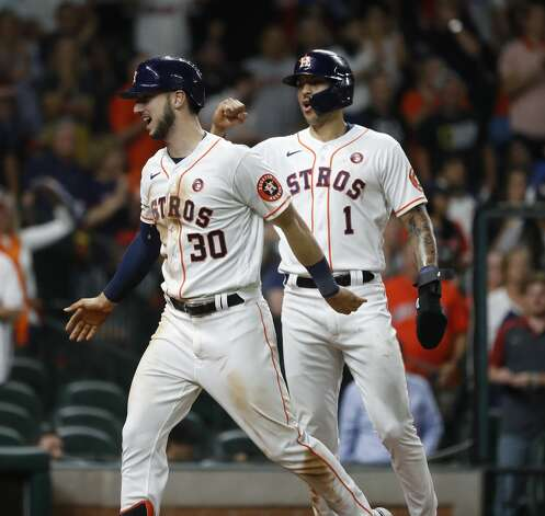 Houston Astros Kyle Tucker (30) celebrates his two-run home run with Carlos Correa during the seventh inning of an MLB baseball game at Minute Maid Park, Saturday, May 15, 2021, in Houston. Photo: Karen Warren/Staff Photographer / @2021 Houston Chronicle