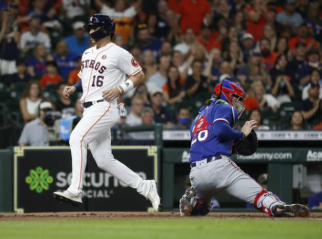 Houston Astros Aledmys Diaz (16) scores a run on Alex Bregman's RBI single off of Texas Rangers starting pitcher Dane Dunning during the first inning of an MLB baseball game at Minute Maid Park, Saturday, May 15, 2021, in Houston. Photo: Karen Warren/Staff Photographer / @2021 Houston Chronicle