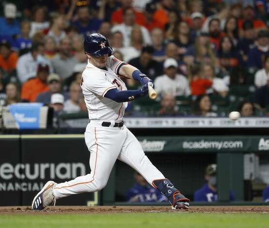 Houston Astros Alex Bregman (2) hits an RBI single off of Texas Rangers starting pitcher Dane Dunning during the first inning of an MLB baseball game at Minute Maid Park, Saturday, May 15, 2021, in Houston. Photo: Karen Warren/Staff Photographer / @2021 Houston Chronicle