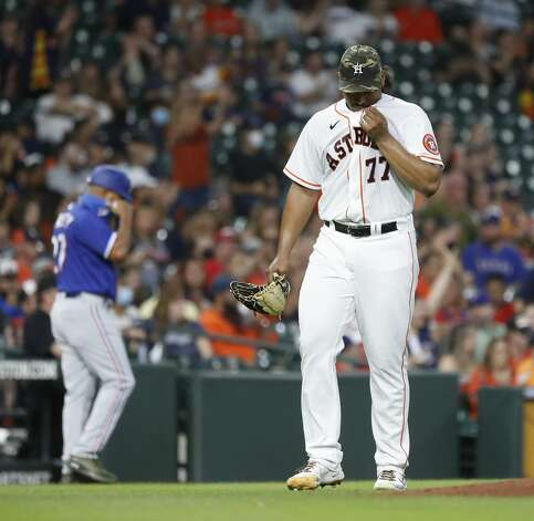 Houston Astros starting pitcher Luis Garcia (77) walks back to the dugout after the end of the top of the first inning of an MLB baseball game at Minute Maid Park, Saturday, May 15, 2021, in Houston. Photo: Karen Warren/Staff Photographer / @2021 Houston Chronicle