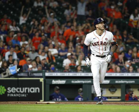 Houston Astros Carlos Correa (1) hits a two-run home run off of Texas Rangers starting pitcher Dane Dunning during the first inning of an MLB baseball game at Minute Maid Park, Saturday, May 15, 2021, in Houston. Photo: Karen Warren/Staff Photographer / @2021 Houston Chronicle