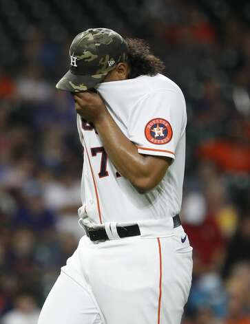 Houston Astros starting pitcher Luis Garcia (77) wipes his face after striking out Texas Rangers Joey Gallo during the third inning of an MLB baseball game at Minute Maid Park, Saturday, May 15, 2021, in Houston. Photo: Karen Warren/Staff Photographer / @2021 Houston Chronicle
