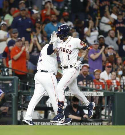 Houston Astros Carlos Correa (1) reacts after hitting a two-run home run off of Texas Rangers starting pitcher Dane Dunning during the first inning of an MLB baseball game at Minute Maid Park, Saturday, May 15, 2021, in Houston. Photo: Karen Warren/Staff Photographer / @2021 Houston Chronicle