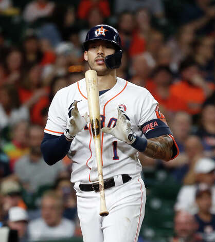Houston Astros shortstop Carlos Correa (1) reacts after striking out against Texas Rangers starting pitcher Dane Dunning during the third inning of an MLB baseball game at Minute Maid Park, Saturday, May 15, 2021, in Houston. Photo: Karen Warren/Staff Photographer / @2021 Houston Chronicle