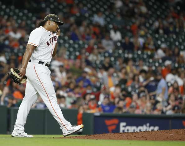 Houston Astros starting pitcher Luis Garcia (77) wipes his face during the fifth inning of an MLB baseball game at Minute Maid Park, Saturday, May 15, 2021, in Houston. Photo: Karen Warren/Staff Photographer / @2021 Houston Chronicle