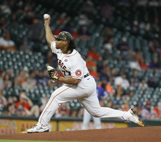 Houston Astros starting pitcher Luis Garcia (77) pitches during the first inning of an MLB baseball game at Minute Maid Park, Saturday, May 15, 2021, in Houston. Photo: Karen Warren/Staff Photographer / @2021 Houston Chronicle