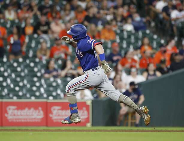 Texas Rangers Nick Solak (15) runs to third base on his triple off of Houston Astros starting pitcher Luis Garcia during the first inning of an MLB baseball game at Minute Maid Park, Saturday, May 15, 2021, in Houston. Photo: Karen Warren/Staff Photographer / @2021 Houston Chronicle