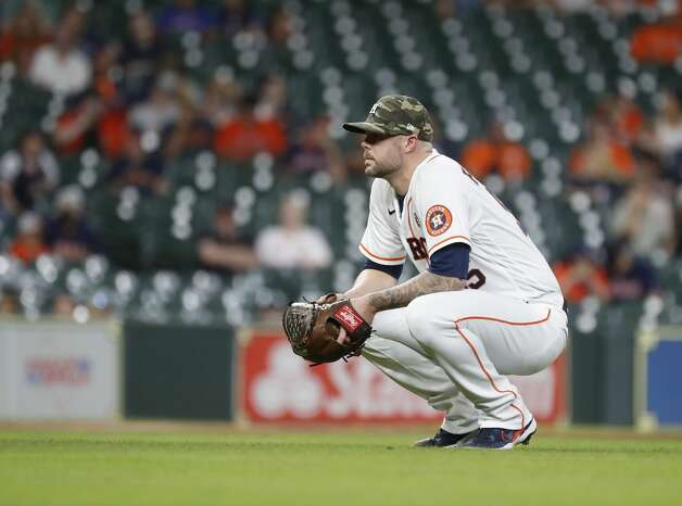 Houston Astros relief pitcher Ryan Pressly (55) watches Texas Rangers Willie Calhoun on the ground after he fouled a ball off his leg during the ninth inning of an MLB baseball game at Minute Maid Park, Saturday, May 15, 2021, in Houston. Photo: Karen Warren/Staff Photographer / @2021 Houston Chronicle