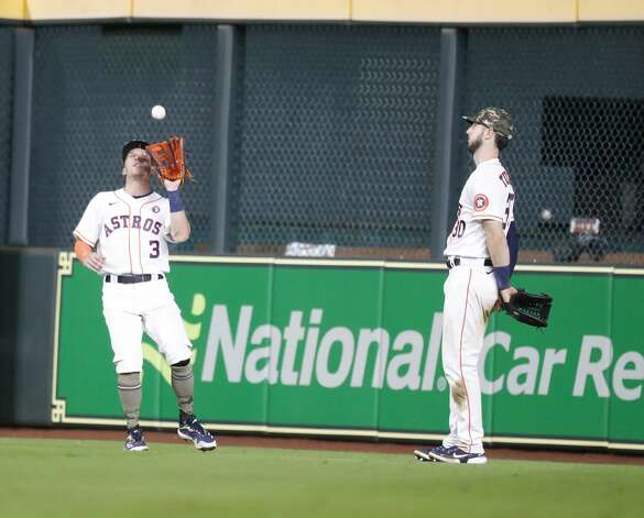 Houston Astros center fielder Myles Straw (3) catches Texas Rangers Willie Calhoun's fly ball during the ninth inning of an MLB baseball game at Minute Maid Park, Saturday, May 15, 2021, in Houston. Photo: Karen Warren/Staff Photographer / @2021 Houston Chronicle