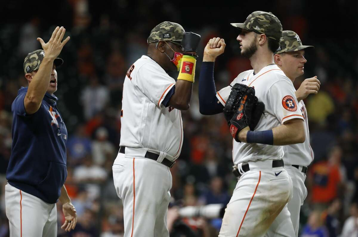 Dusty Baker (center) still wears a mask despite the Astros reaching the 85 percent threshold to have protocols relaxed. He asked for better adherence to mask wearing by non-vaccinated fans when Minute Maid Park is opened to full capacity for the next homestand.