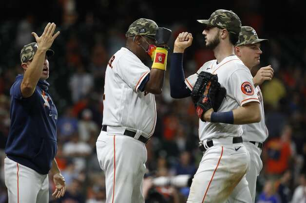 Houston Astros manager Dusty Baker Jr. (12) celebrates the Astros 6-5 win over the Texas Rangers with Kyle Tucker during the ninth inning of an MLB baseball game at Minute Maid Park, Saturday, May 15, 2021, in Houston. Photo: Karen Warren/Staff Photographer / @2021 Houston Chronicle