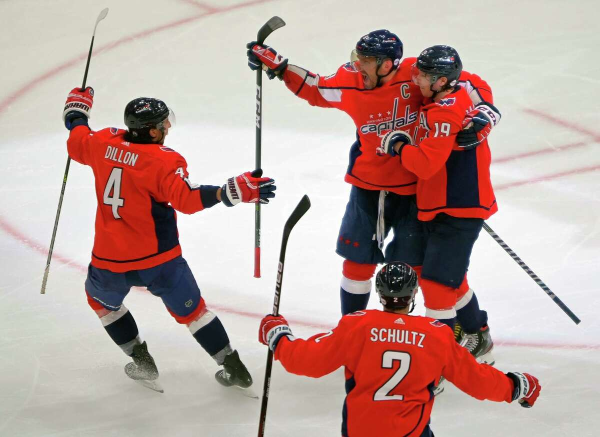Capitals left wing Alex Ovechkin (8) is embraced by center Nicklas Backstrom (19) as he celebrates his second-period goal with teammates during their playoff game against the Boston Bruins at Capital One Arena on May 15, 2021.