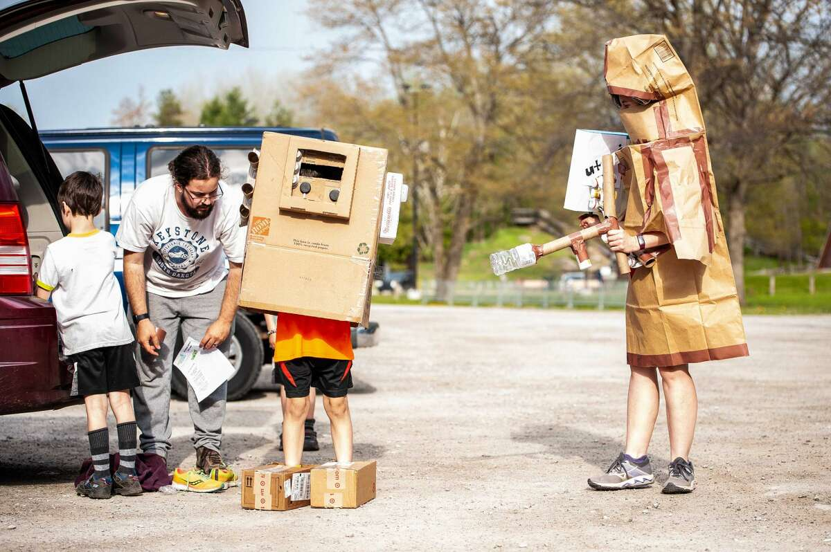 Luke Frye, 7, and Mandy dress in cardboard and paper Star Wars costumes at the Midland Recyclers 5K Fun Run/Walk event on May 15, 2021, at the Midland City Forest. Participants were encouraged to make their costumes out of recycled materials.