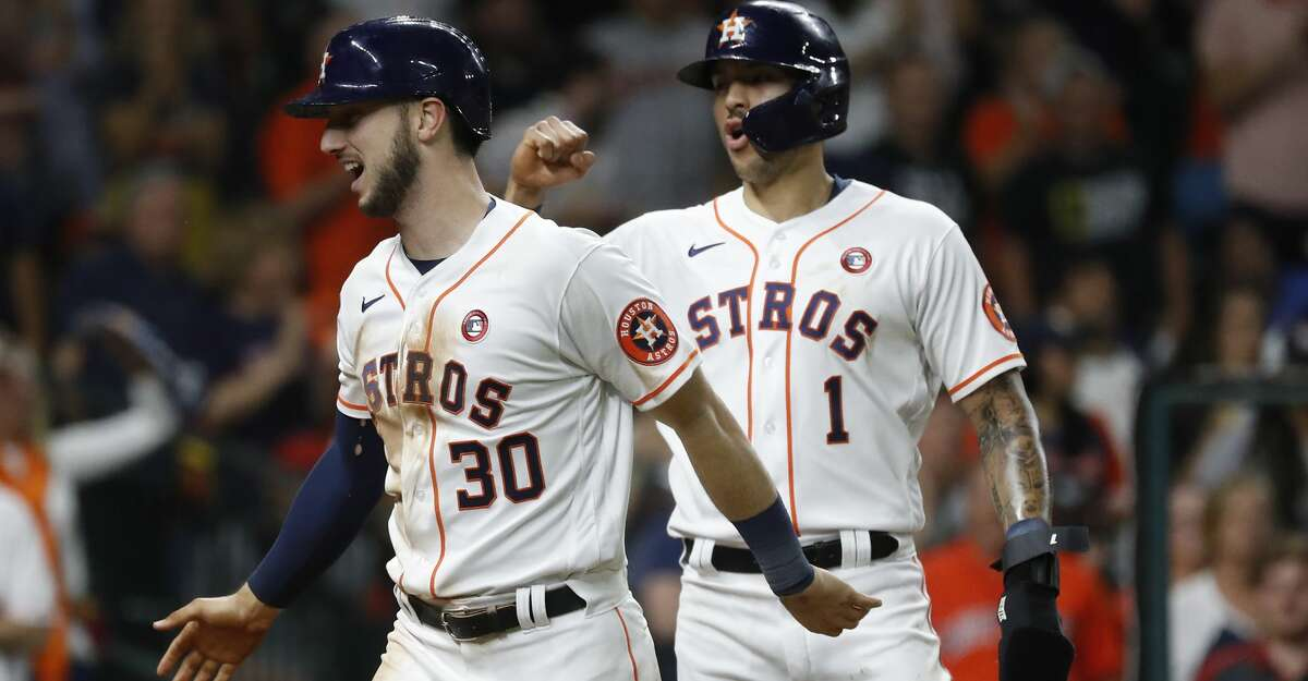 Houston Astros Kyle Tucker (30) celebrates his two-run home run with Carlos Correa during the seventh inning of an MLB baseball game at Minute Maid Park, Saturday, May 15, 2021, in Houston.