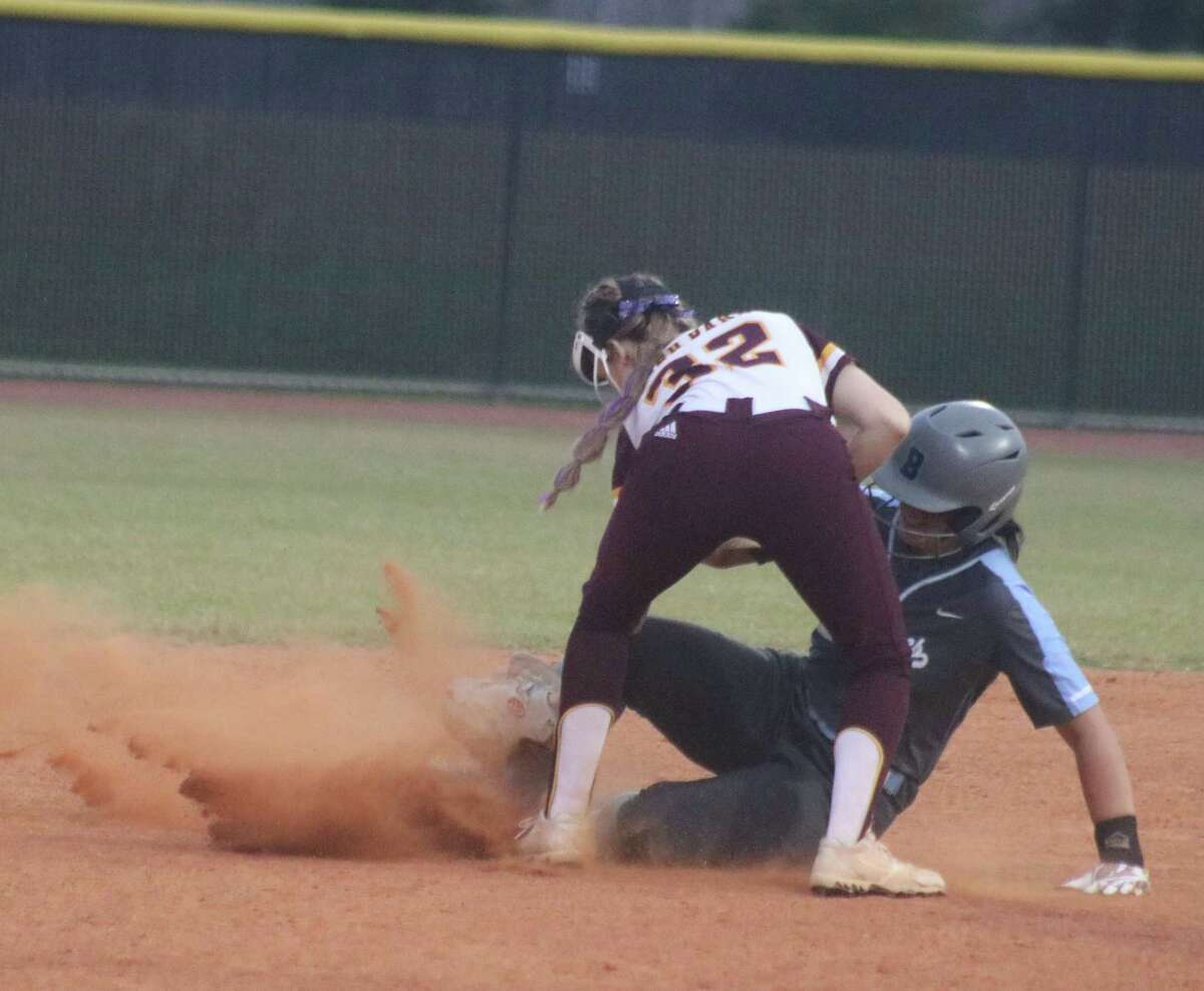 Deer Park shortstop Madison Bailey tags out Taylor Barton during third-inning play that saw the lady Bucs begin to sneak back into the contest. Barton had just singled home two runs, but was thrown out going for two bags.