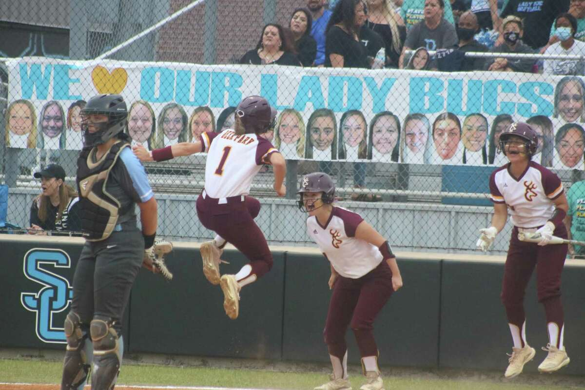 Haidyn Hardcastle (1) jumps for joy as she crosses home plate to score Deer Park's sixth run Saturday night during a six-run first inning.