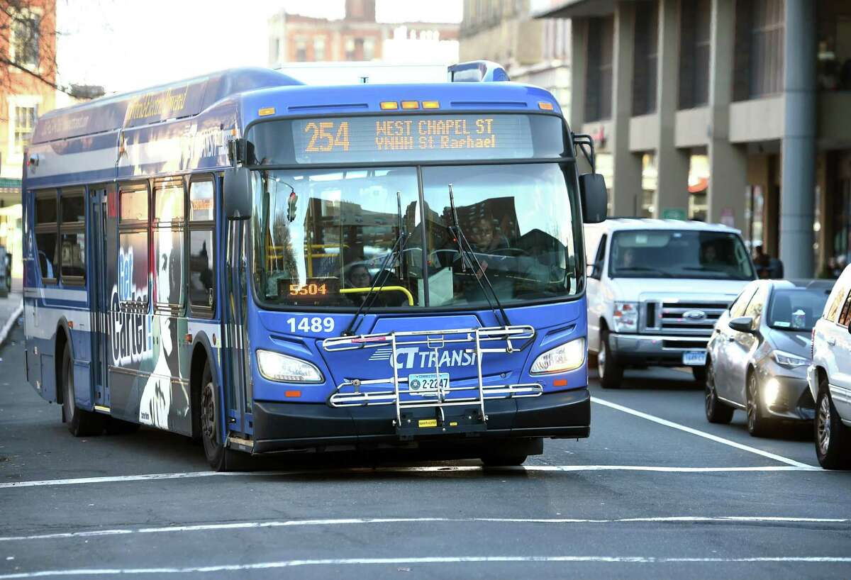 A CT Transit bus pulls away from a bus stop on Chapel Street in New Haven on November 21, 2019.