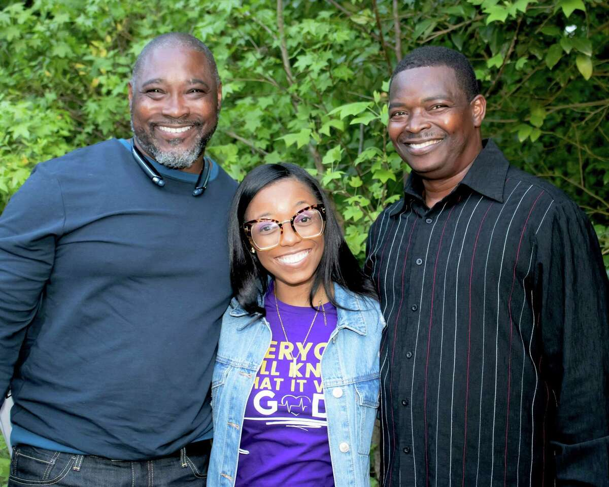 Sana Cotten, of Middletown, center, was placed in foster care at a young age. On New Year's Eve, after searching for her entire life, she found her birth family, and, late last month traveled to North Carolina. Shown here are her newly discovered brothers Horatio Fox, left, and Alan Joyner, right.