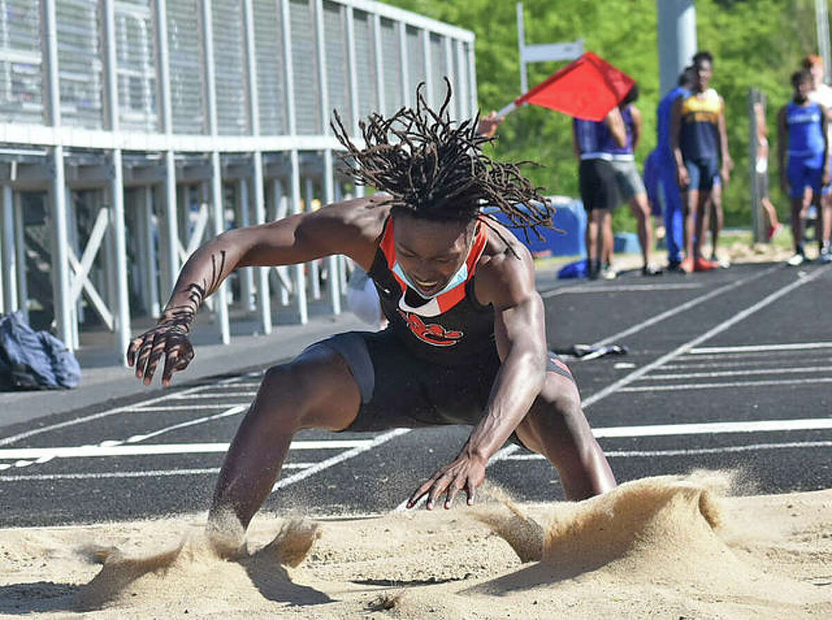Edwardsville's Malik Allen competes in the triple jump Friday at the Triad Invitational. Allen took second.