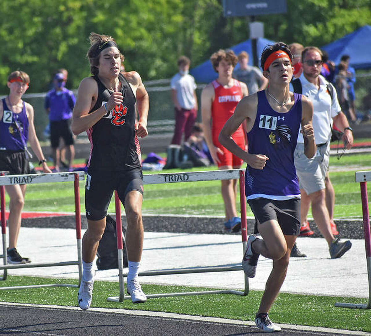 Edwardsville's Drew Law, left, competes in the 800-meter run on Friday at the Triad Invitational in Troy.
