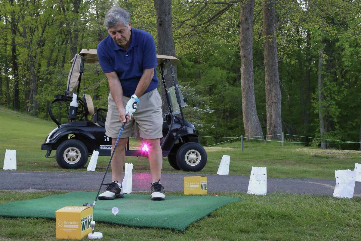 Nick Morello, of Fairfield, gets ready to shoot at the Glow on the Green! event at the H. Smith Richardson Golf Course on Friday, May 14, 2021, in Fairfield, Conn.