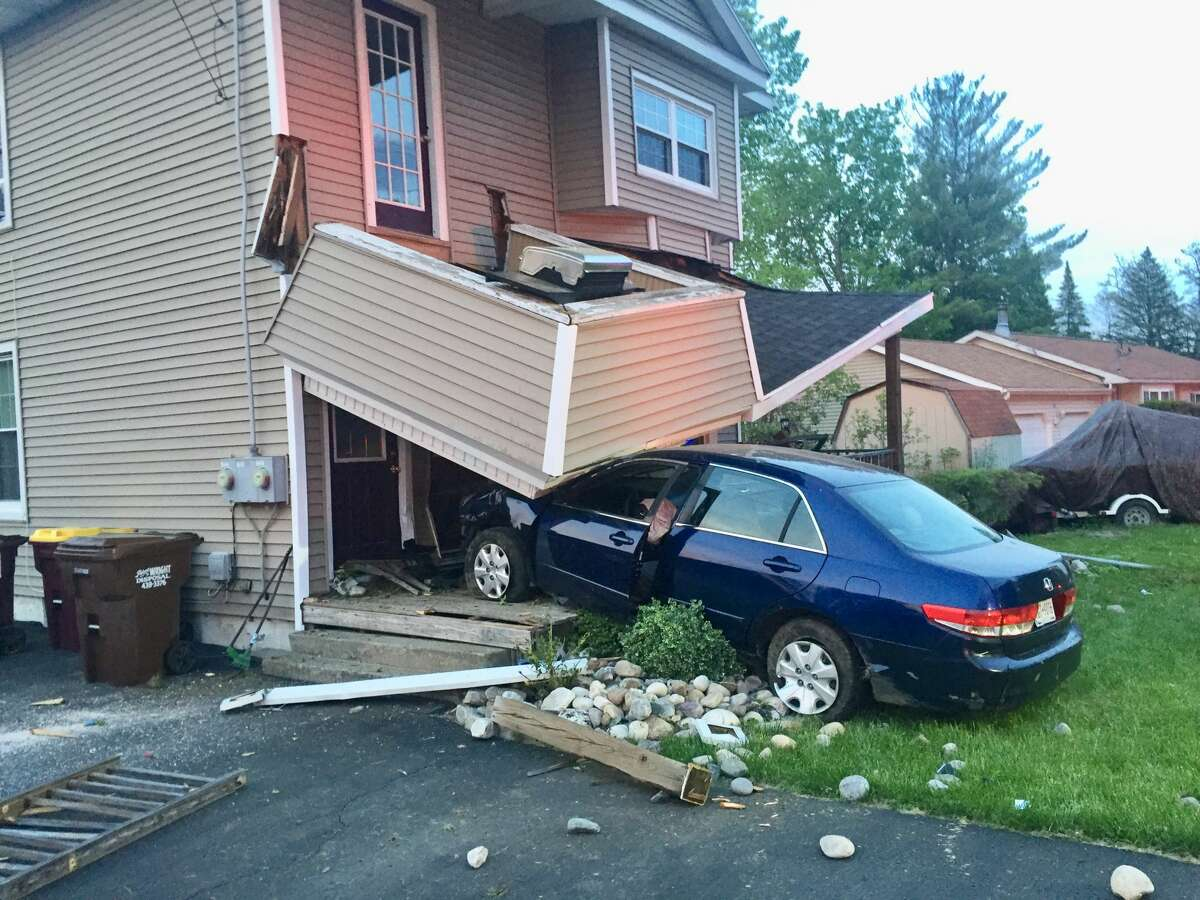 Police and firefighters responded to Corning Hill Road in Bethlehem Saturday, May 15, 2021 after a car crashed into a home, causing a support for a lower roof to collapse.