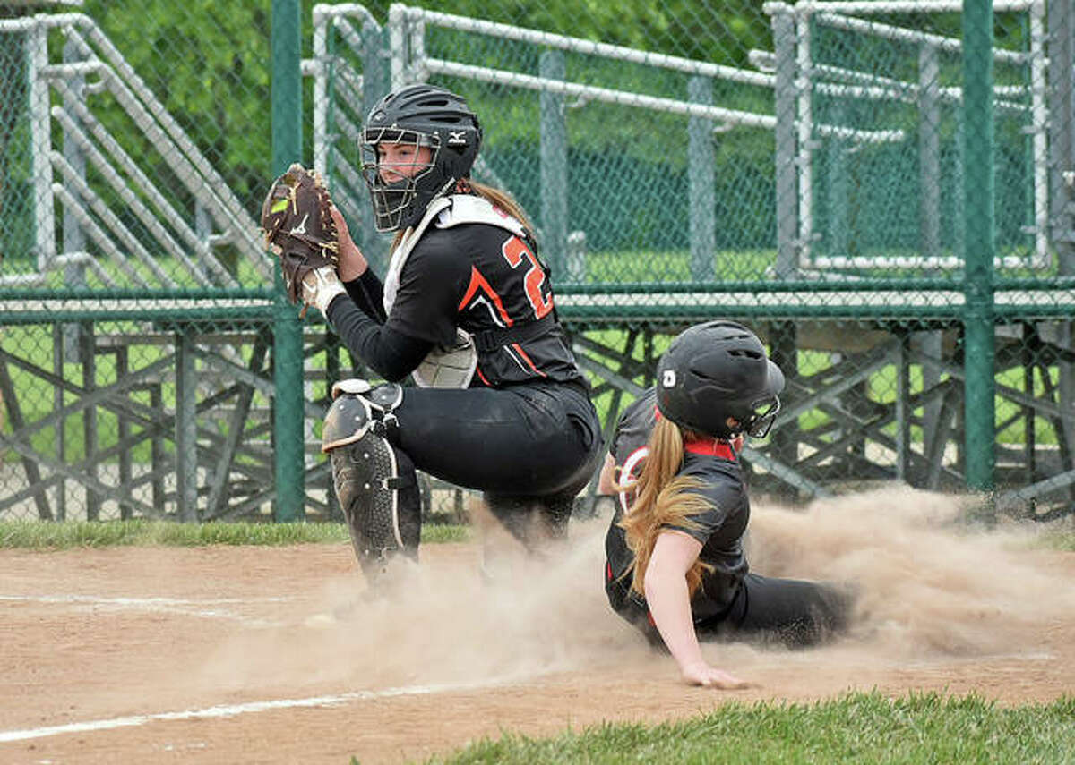 Edwardsville catcher Lexie Griffin gets a force out at home in the third inning against Huntley in the first game of a doubleheader on Saturday.