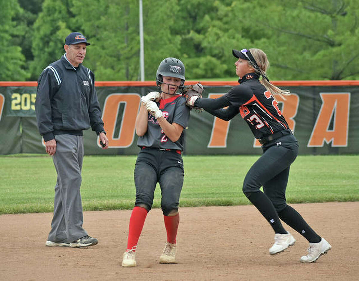 Edwardsville's Lexi Gorniak tags out Huntley's Reese Hunkins in the second inning of the first game of a doubleheader on Saturday.
