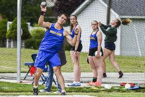 """Midland's Nolan Berg competes in the first annual """"Punch a Hole in the Sky"""" throwers meet Saturday, May 15, 2021 at Midland High School. (Adam Ferman/for the Daily News)"""