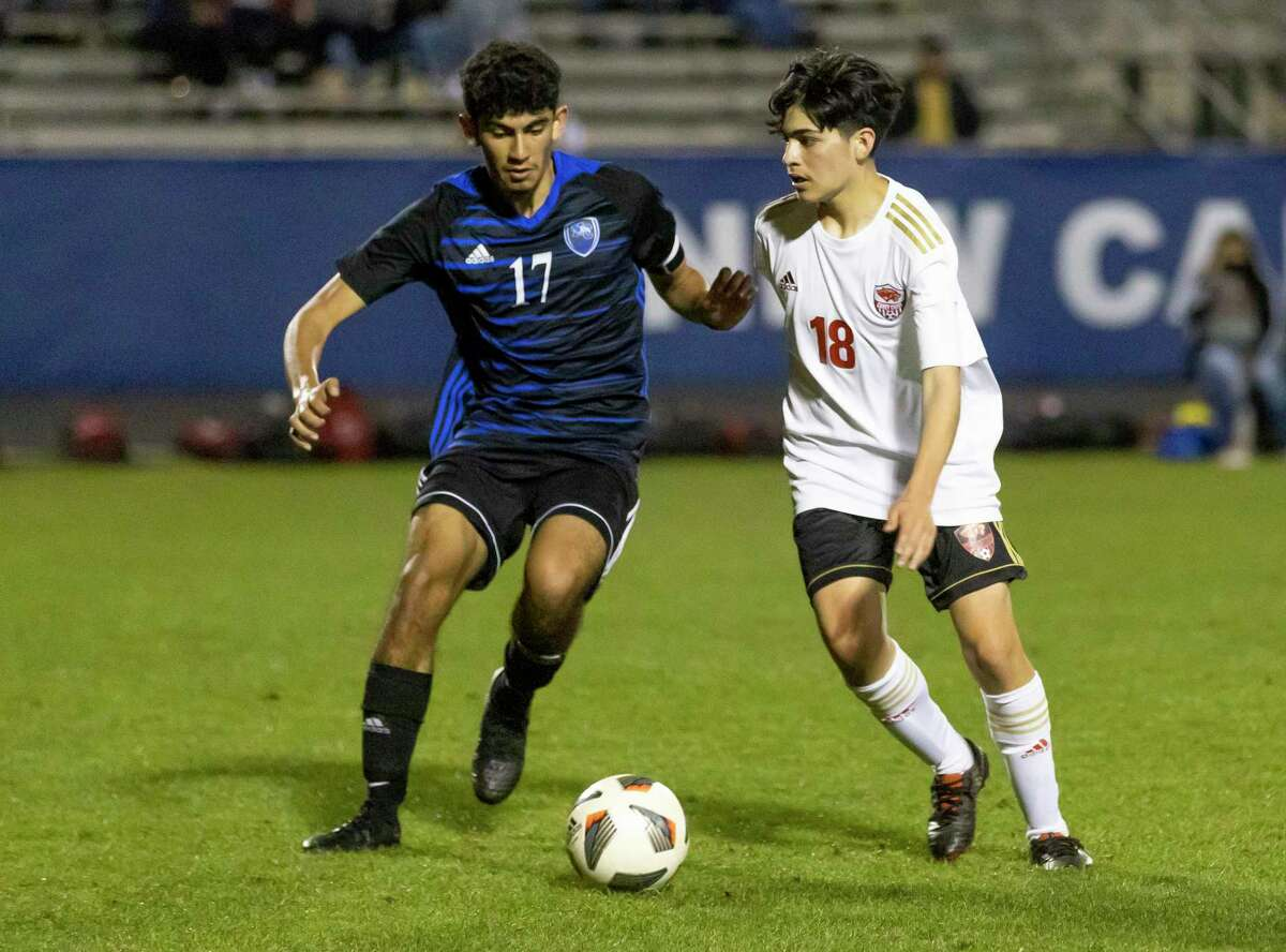 New Caney Miguel Rodriguez (17) and Caney Creek Tristan Obrajero (18) fight for control of the ball during the second half of a District 20-5A boys soccer match at Don Ford Stadium, Tuesday, March 9, 2021, in New Caney.