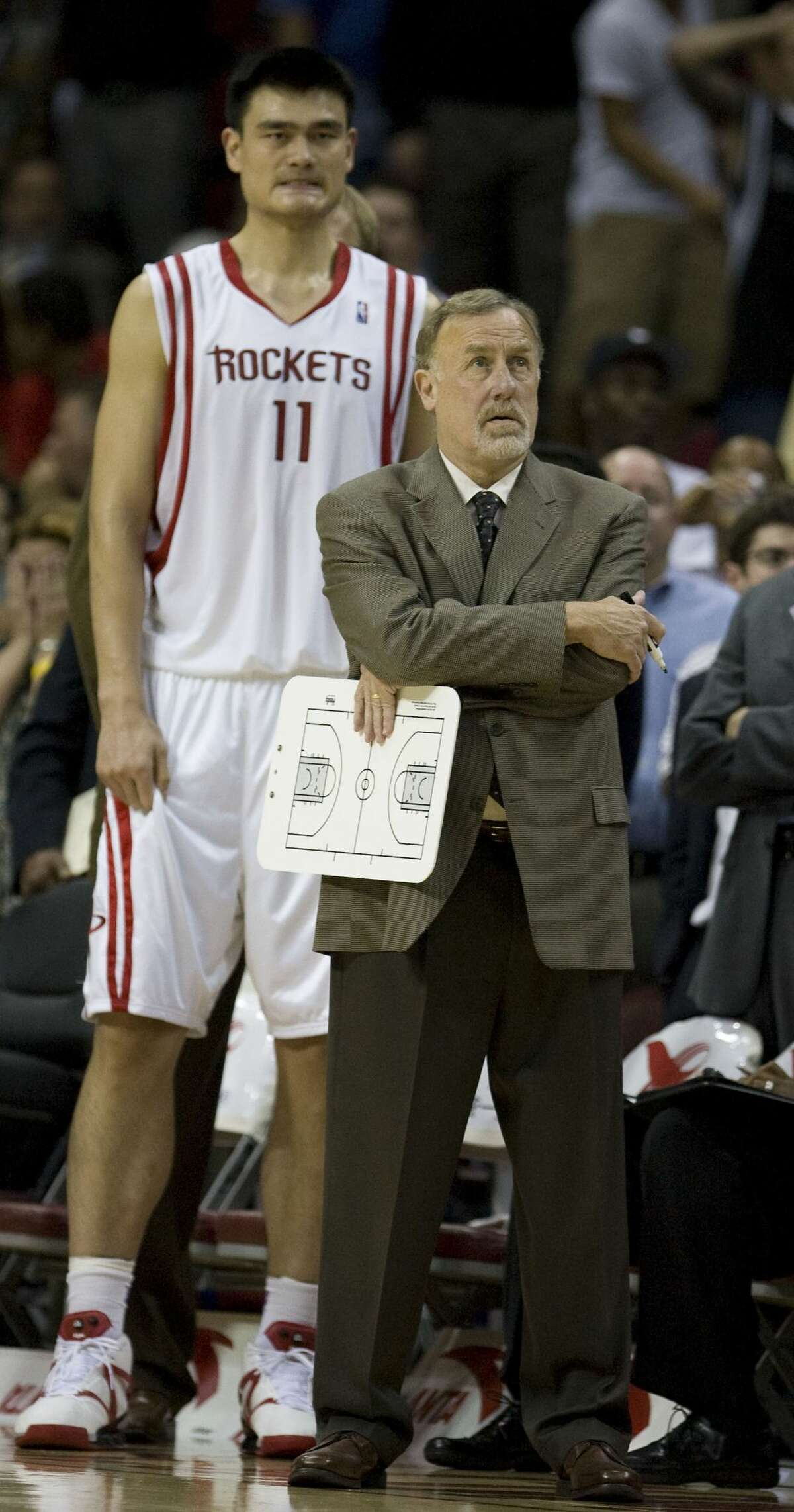 The Houston Rockets head coach Rick Adelman (right) and Yao Ming during the fourth quarter of NBA game action against the Boston Celtics at the Toyota Center Tuesday, Nov. 4, 2008, in Houston. ( James Nielsen / Chronicle )