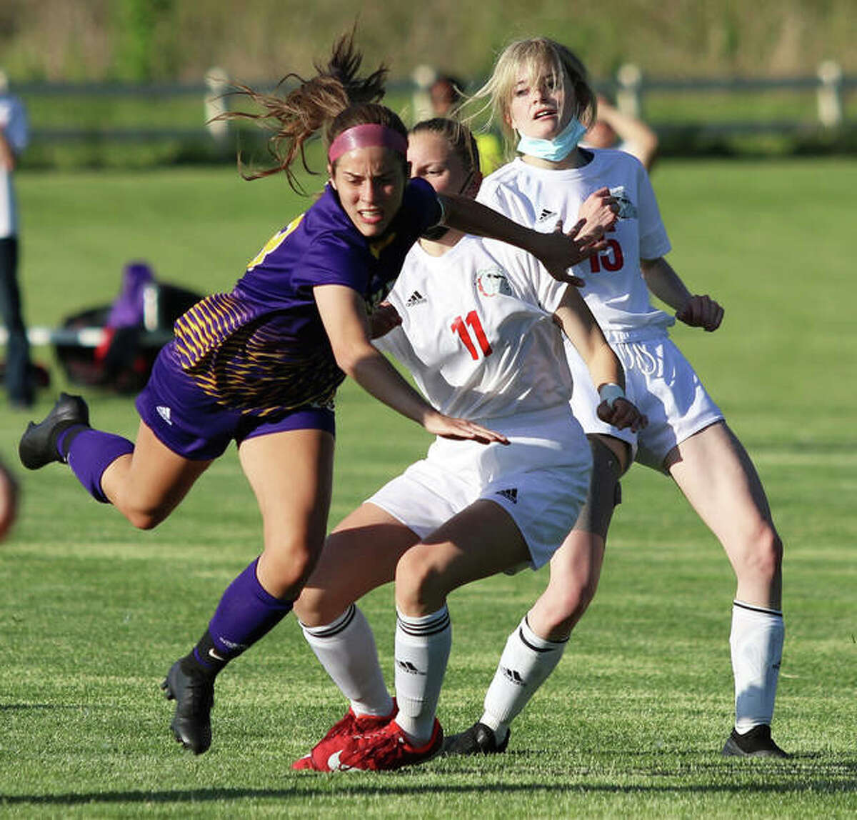 CM's Katie Peterson (left) is fouled by Highland's Bella Kallal (11) with the Bulldogs' Kaitlyn Rider also defending on the play in the Eagles' 7-0 win in a Mississippi Valley Conference girls soccer match on Thursday at the Bethalto Sports Complex. The Eagles were back on their home pitch Saturday and posted another 7-0 shutout against the Jersey Panthers. CM led Jersey 6-0 at halftime. Aubree Wallace had two goals, with Peterson, Mady Zyung, Ellah Brown, Ellie Little and Claire Christeson also scoring for CM, which had Emily Williams and Little split time in goal. CM is 5-6-1 and 3-3 in the MVC. Jersey is 4-9 and 1-5 in the league.
