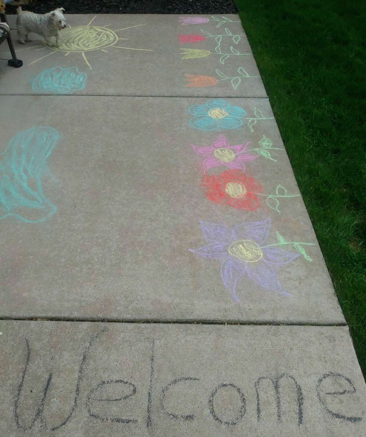Residents of Manistee Place Apartments who created chalk drawings on Sunday will receive $10 gift cards. (Kyle Kotecki/News Advocate)