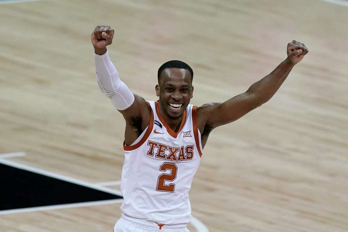 Texas' Matt Coleman III celebrates after the team's win over Oklahoma State in an NCAA college basketball game for the championship of the Big 12 men's tournament in Kansas City, Mo, Saturday, March 13, 2021. (AP Photo/Charlie Riedel)