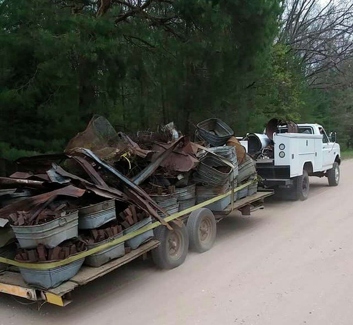 The Dublin Heights Sports Club led a cleanup event at the Arboretum Trail near WellsonSaturday. A group of roughly 35 volunteers cleared out around 400 galvanized buckets, rolls of barbed wire, piping and other items in an effort to reestablish the trail as a recreational site. (Courtesy photo)